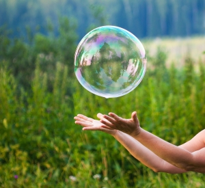 hand-catching-a-soap-bubble